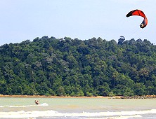 Kite-surfing against a gorgeous backdrop. This is kite-surfing Tanjung Resang!
